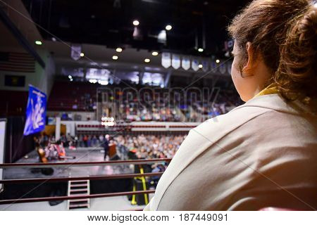 MISSOULA, MONTANA, USA - May 20, 2017: Woman listens to Senator Bernie Sanders speak at US House candidate Rob Quistâ??s 2017 Montana special election rally at University of Montana