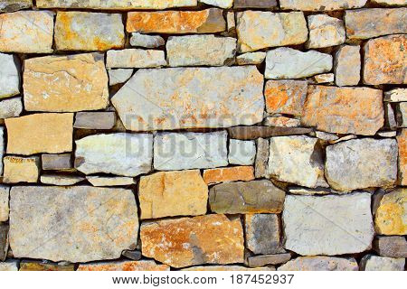 Texture of colourful dry masonry, may be used as background