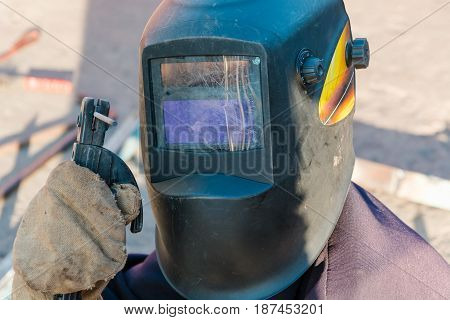 tame welder. the welder welds iron. the welder welds metal. the welder on metal. poster