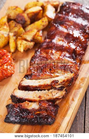 Roasted pork ribs marinated in barbecue sauce and glazed with honey