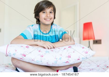 Child on bed in bedroom