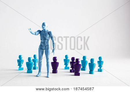 Male Leadership Concept Portrayed With Male And Female Figurines. Isolated On White With Copy Space.