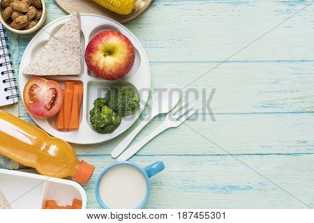 Healthy lunch box on wooden background, top view