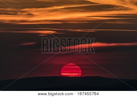 Red sunset over mountains in Decin town area