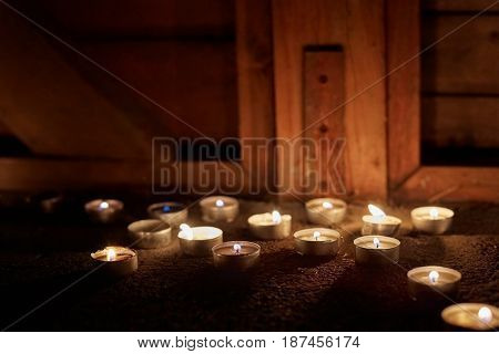Burning candles in a wooden building