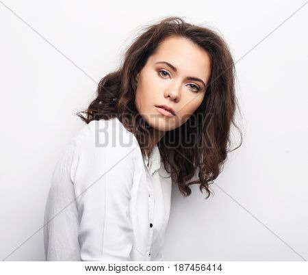 lifestyle, fashion and people concept: beautiful woman wearing casual clothes, posing on white background