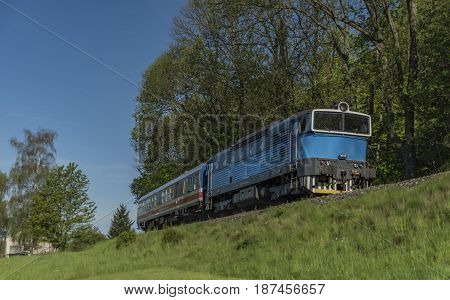 Blue engine in green spring day near Jiretin village