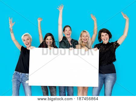 Happiness group of women arms raised and holding blank banner