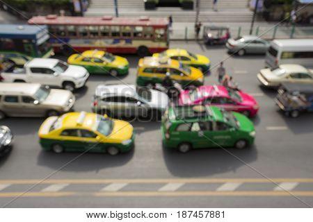 blurred scene of car in traffic jam in rush hour in ratchaprasong area Bangkok Thailand