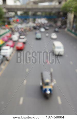defocused scene of traffic in ratchaprasong area Bangkok Thailand