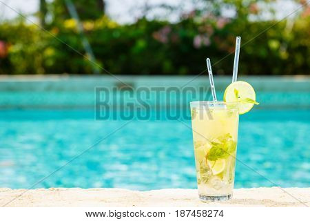 Mojito Cocktail At The Edge Of A Resort Pool.  Concept Of Luxury Vacation