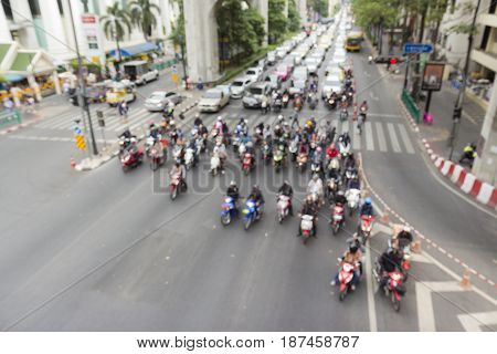 blurred background of traffic in red light signal at ratchaprasong junction in Bangkok Thailand