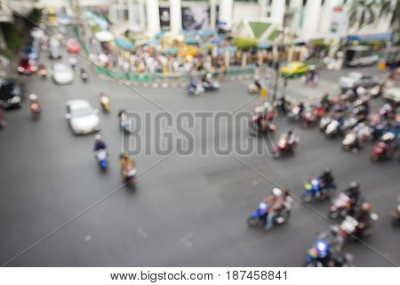 defocused scene of traffic at ratchaprasong junction in Bangkok Thailand