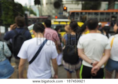 defocused scene of unidentified pedestrian in ratchaprasong junction in Bangkok Thailand