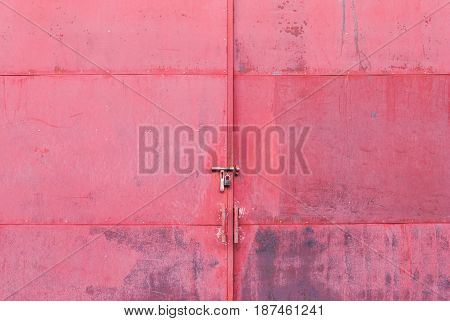 Closeup To Red Old Metal Big Door With Padlock Background
