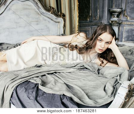 curly hairstyle girl in luxury house interior, rich young people concept close up