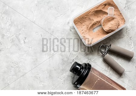 nutrition for workout with protein cocktail powder and bars on stone table background top view mockup