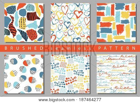 Vector Set of seamless pattern with brush stripes and strokes. Blue red color on white background. Hand painted grange texture. Ink geometric elements. Fashion modern style. Endless fabric retro print.