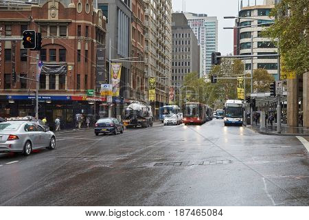 SYDNEY, AUSTRALIA - APRIL 3, 2014: View from Sydney Park Street with buildings and traffic in rainy weather