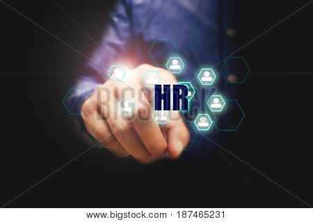 Human resources concept businessman pressing hr text and people in icon.
