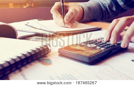 Young Woman Writing Make Note And Doing Calculate Finance At Home Office.