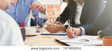 Group of business people having a meeting in casual office panoramic banner