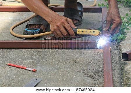The Welders working on floor in Thailand