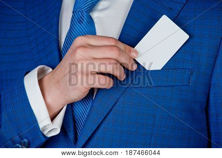 Business Man Who Takes Out Business Card From The Pocket