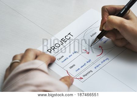 Hands working on document network graphic overlay