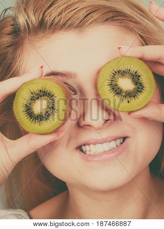 Woman Holding Green Kiwi Fruit Like Eyeglasses