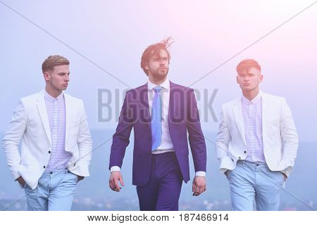 People Of Young Man, Businessman, Guys Walking On Blue Sky