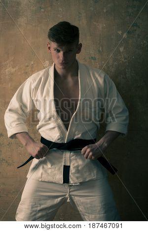 Caucasian Karate Man In White Kimono