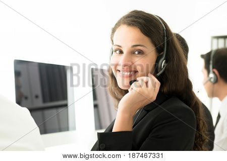 Businesswoman working in call center as a customer service staff or telemarketer
