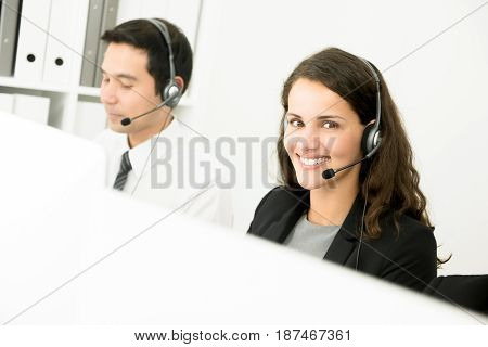 Young smiling beautiful business woman working in call center