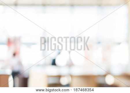 Abstract blur white bokeh background from restaurant interior