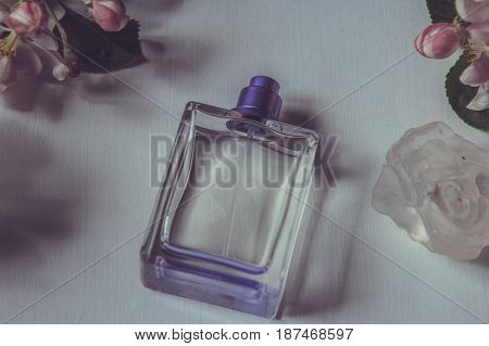 Women's Perfume And Spring Apple Blossom Branch. Female Romantic Perfumes