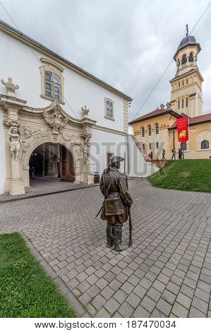ALBA IULIA Romania - APRIL 30 2017: Bronze statue with soldier in front of one Gate of the City in Citadel of Alba Iulia city. APULUM ROMAN FESTIVAL organized by the City Hall.