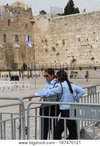 JERUSALEM, ISRAEL - APRIL 30, 2017: Israeli Policewomen provide security next to the Western Wall in the Old City of Jerusalem.