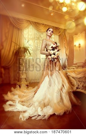 Beauty gorgeous woman in beautiful evening dress in luxurious style interior room. Elegant lady full length portrait in golden dress