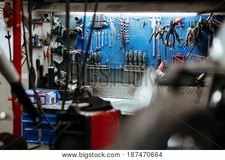 Empty workplace of technician with repairing equipment