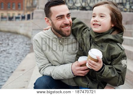Happy boy and his father spending time outdoors