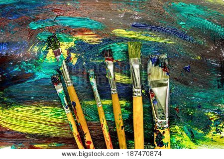 abstract pattern with multicolored oil paintings texture with brushes for artist design