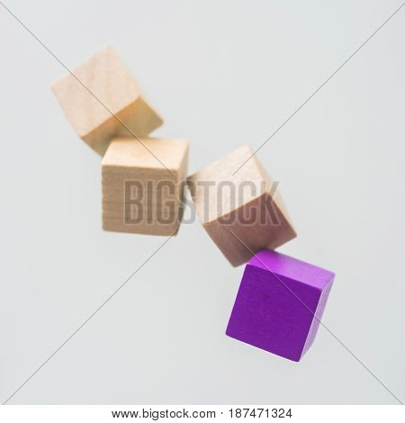 Business concept - Abstract geometric real floating wooden cube on grey background and it's not 3D render. the symbol of leadership teamwork and growth.