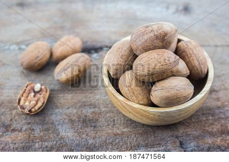 Chinese walnut kernels dried fruit food on rustic old wooden table