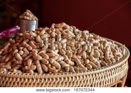 The boiled groundnut in the rattan basket.