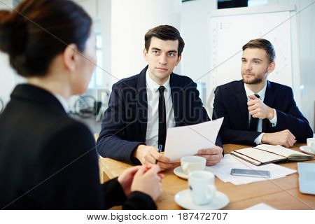 Employer listening to candidate for new vacancy with her resume