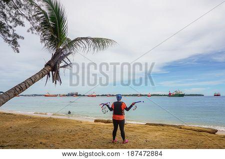 Labuan,Malaysia-Feb 19,2017: woman ready to having fun doing snorkel watersport activity in Papan island of Labuan,Malaysia.