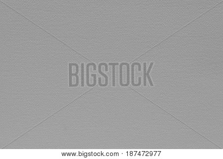abstract grained texture of speckled fabric or paper material of pale gray color