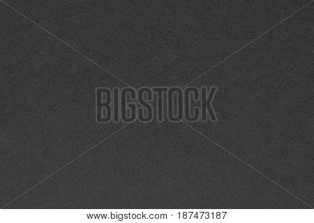 abstract texture of a cardboard or paper material of black color for a background or for wallpaper
