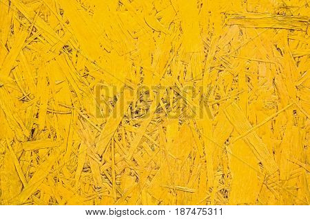 Close-up texture of bright yellowparticle board surface